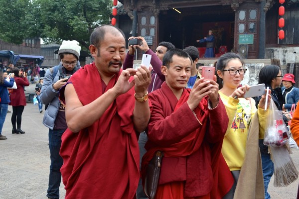 Monks with smartphones