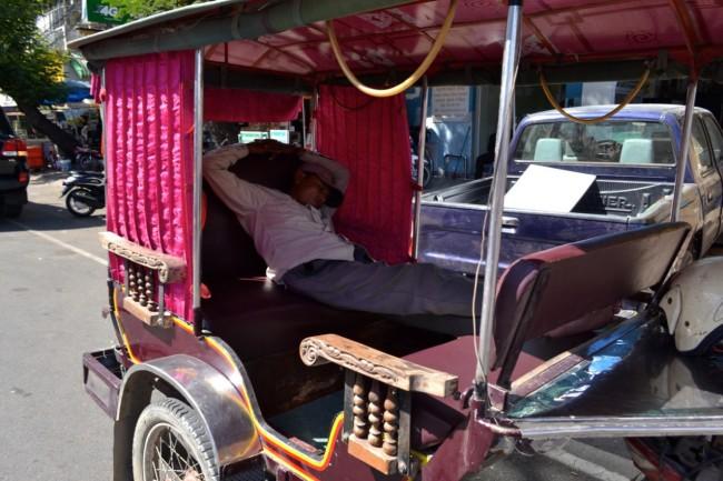 Sleeping tuk tuk driver